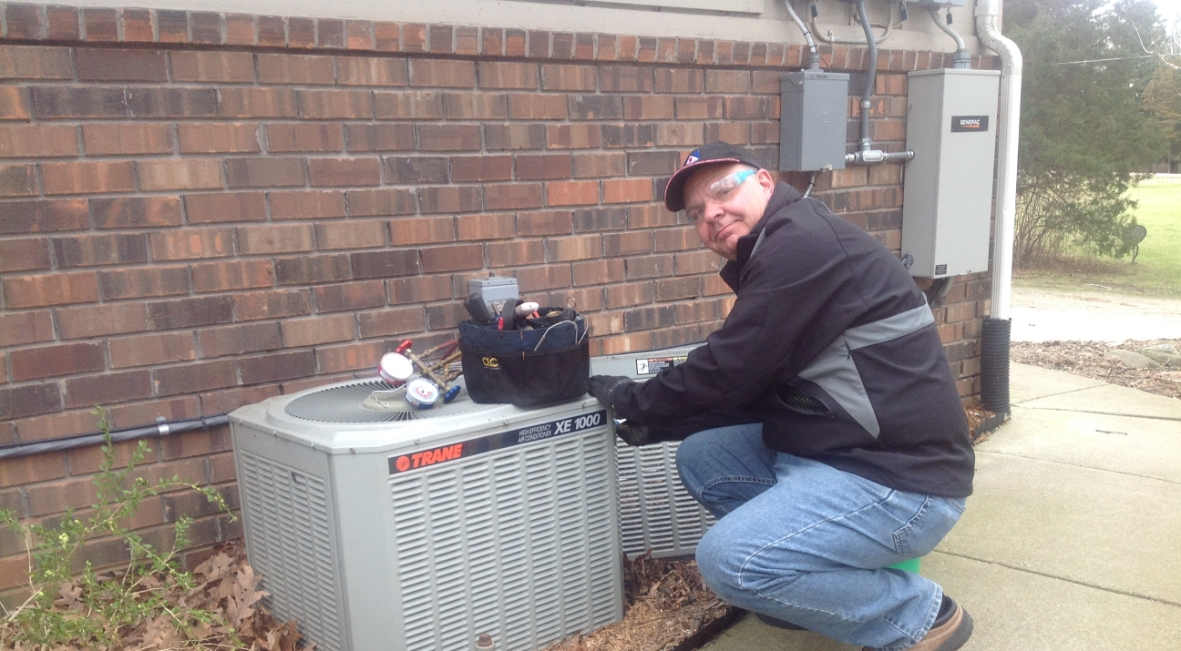A picture of Bob working on an AC unit